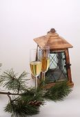 New Year's still-life with a small lamp, champagnes a fur-tree branch