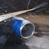 Turbine aircraft in the winter during a heavy snowfall