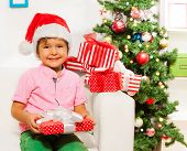 Happy little boy with many xmas presents