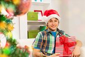 Teen happy boy with Christmas presents