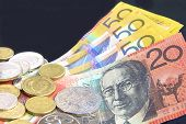 image of twenty dollars  - Australian fifty dollar notes and gold and silver coins. ** Note: Shallow depth of field - JPG