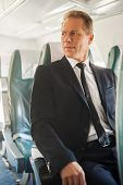 Businessman In Airplane.