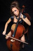 beautiful female musician playing a cello.
