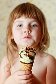 Beautiful Little Girl Holds Ice Cream. Shallow Dof. Focus On Ice Cream