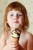 Beautiful Little Girl Holds Ice Cream. Shallow Dof. Focus On Ice Cream