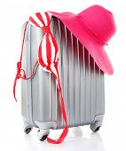 Travel suitcase, hat, swimsuit isolated on white