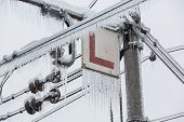 Frozen Electrical Lines For Railroad With Icicles