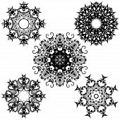 A decorative set round black ornaments on white