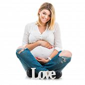 happy beautiful pregnant woman sit in blouse and jeans  on white background