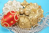 red christmas ball with golden ornaments