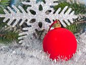New Year's red ball and decorative snowflake