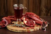 Peeled Pomegranate, Glass Of Pomegranate Juice And Jewerly On Wooden Board