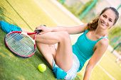 Young Female Tennis Player Resting