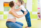 Pregnant Mother Kissing With Daughter