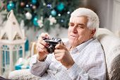 Senior man looking at retro style camera