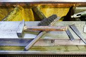 Hammer And Metal Brush On Boring Machine