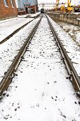 Railroad In Industrial Area In Winter