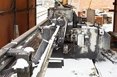 pic of bender  - steel wires and reinforcing steel cutting and bender machine in outdoor workshop - JPG