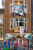 Urban Graffiti On A Dilapidated House On The Street Spui In Amsterdam