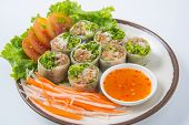 Fresh Spring Rolls With Dipping Sauce On A White Background.