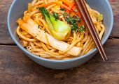 picture of chopsticks  - hand pulled stretched Chinese ramen noodles on a bowl with chopstick - JPG