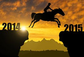 stock photo of year horse  - The rider on the horse jumping into the New Year 2015 - JPG