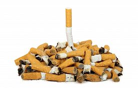 foto of tobacco smoke  - quit smoking concept with whole cigarette among cigarette butts - JPG