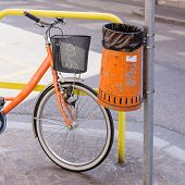 stock photo of polution  - Trash metal orange waste of road and bicycle - JPG