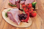image of kale  - fresh raw turkey meat steak fillet with vegetables kale tomatoes lettuce red hot chili pepper and dark olives on cutting board over wooden table - JPG