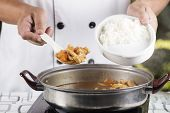 picture of pork  - Chef shovel Japanese pork curry with steam rice  - JPG