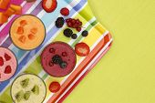 picture of smoothies  - Assorted fruits smoothies on multicolored tray and green tablecloth - JPG