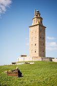 foto of hercules  - Man contemplating Hercules tower lighthouse in La Coruna Spain in a sunny day - JPG