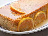 pic of custard  - Orange custard in a studio shot - JPG
