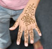 Henna Painting On A Child Hand