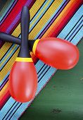 foto of maracas  - Happy Cinco de Mayo background with colorful maracas on Mexican theme dark green distressed table with copy space - JPG