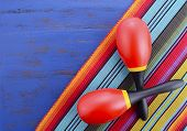 picture of mexican  - Happy Cinco de Mayo background with colorful maracas on Mexican theme dark blue distressed table with copy space - JPG