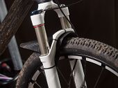 foto of suspension  - Mountain bike suspension detail in a workshop - JPG