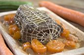 image of pot roast  - roast beef at the wine sauce and carrots don