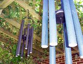 picture of windchime  - windchimes hanging from residential backyard ivy arbor - JPG
