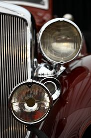 stock photo of muscle-car  - Color detail on the headlight of a vintage car - JPG