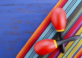 image of mexican fiesta  - Happy Cinco de Mayo background with colorful maracas on Mexican theme dark blue distressed table with copy space - JPG