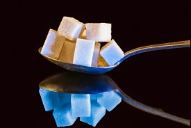 pic of carbohydrate  - Tablespoon chunks of sugar and flips the image in a cool blue tone - JPG