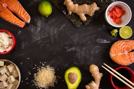 stock photo of soy sauce  - Overhead shot of ingredients for sushi on dark background - JPG