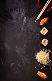 picture of soy sauce  - Overhead shot of sushi on dark background - JPG