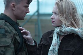 picture of say goodbye  - Young beauty woman and soldier saying goodbye - JPG
