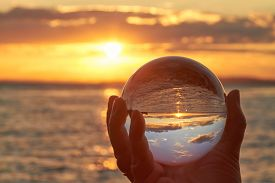 foto of oracle  - The sun sets over Lake Constance in Germany and lit by a crystal ball - JPG