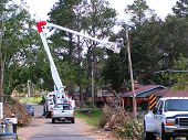 pic of katrina  - repairing utility poles after hurricane katrina - JPG