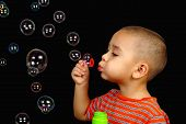 pic of crew cut  - Horizontal portrait of a child blowing bubbles - JPG