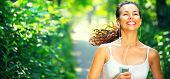 Running sporty woman. Female Runner Jogging during Outdoor Workout in a morning Park. Beautiful fit  poster