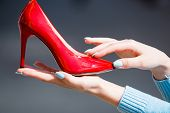 Shoe Red Color Leather On Female Hand poster